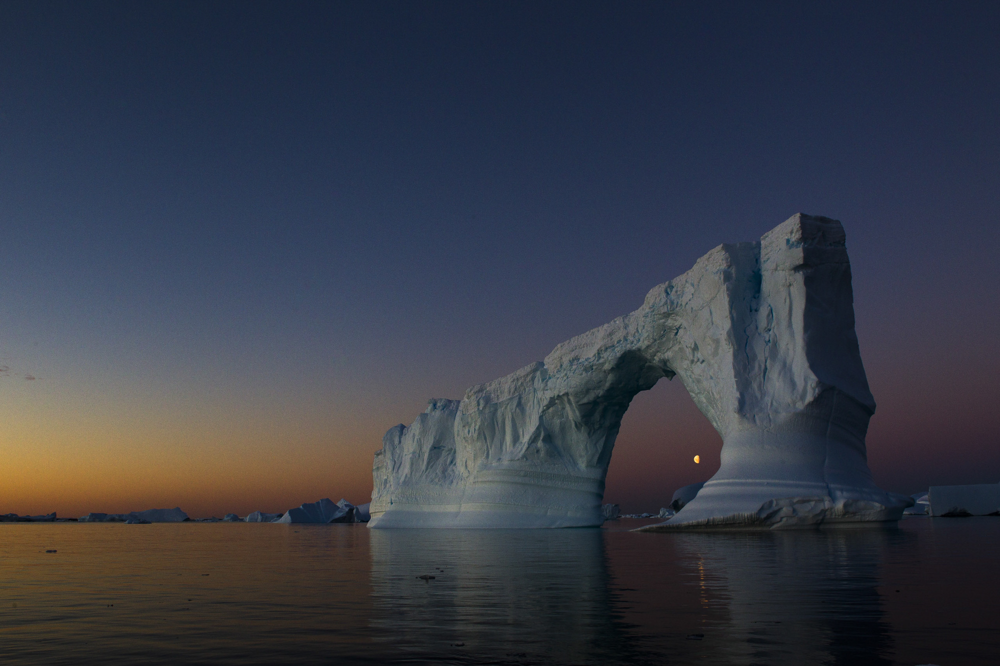 An iceberg arch in Pleneau Bay on the Antarctic Peninsula, Antartica/Photo by Krystle Wright